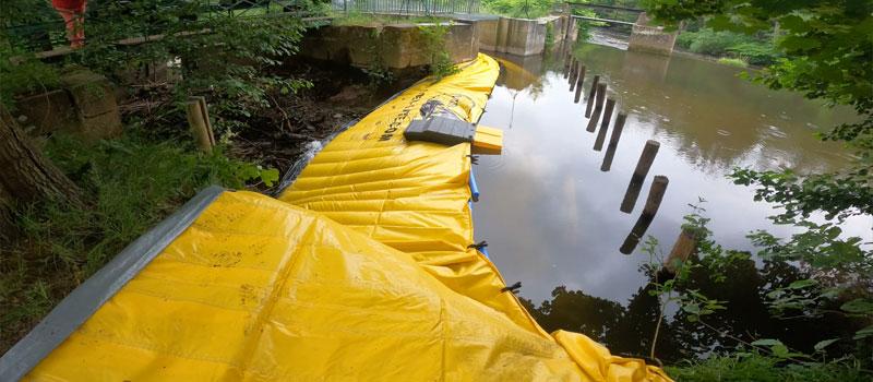 Afwijking van een rivierarm door flexibele kisterdam Water-Gate ©   Reparatie van het Bruche ziftsysteem in Mutzig